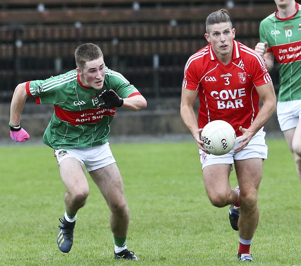Rathgormack's James Power takes on Stradbally's Tony Grey during the semi-final of the J.J.Kavanagh & Sons Senior Football Championship in Fraher Field.
