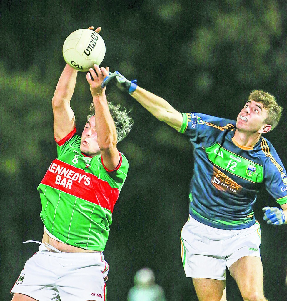 Rathgormack's Sean Clancy wins the ball ahead of Gaultier's Niall McSweeney during the Junior 'B' Football final at St Molleran's