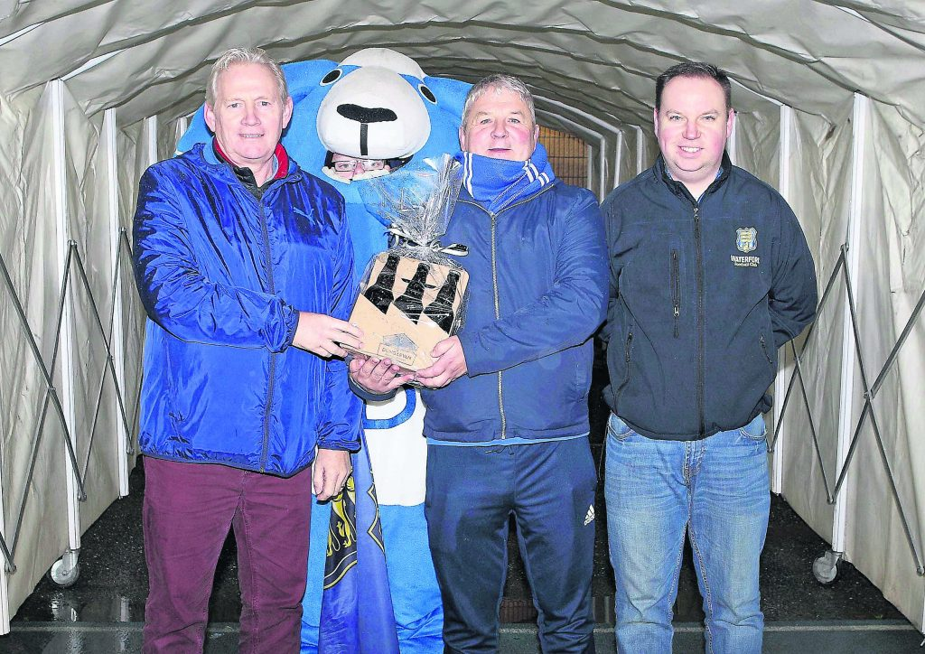 Frankie Walsh was the October winner of the Blue Supporters Club Draw and he is pictured receiving his prize sponsored by Dungarvan Brewing Company from Martin Walker, Chairman BSC and Owen Power, Treasurer BSC