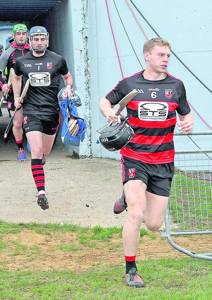 Ballygunner captain, Philip Mahony leads his team out against Limerick champion's Patrickswell in Walsh Park.