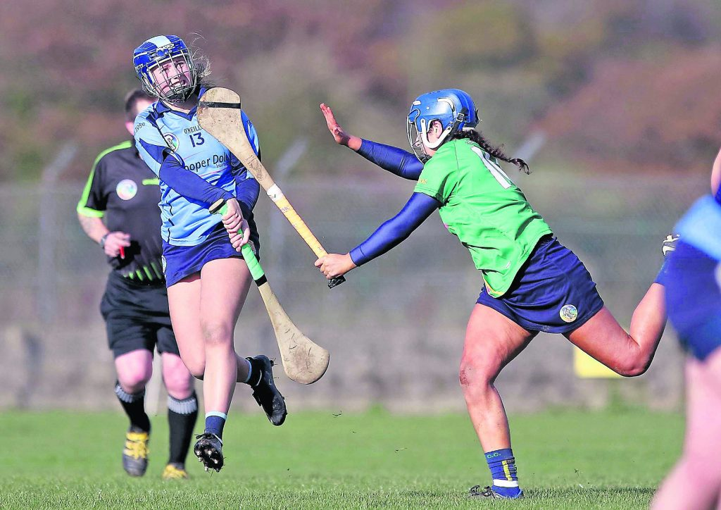 Gailltír's Annie Fitzgerald fires over a great point from play under pressure from Toomevara's Shauna Quirke.