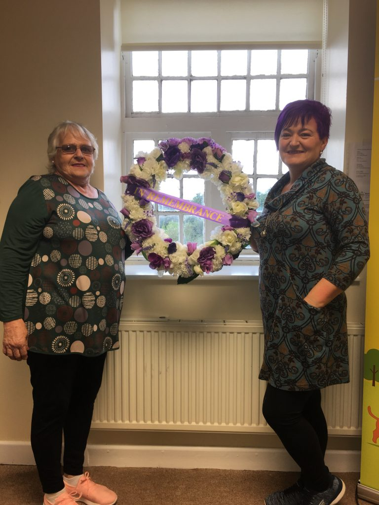 Jo Hallahan and Margaret White pictured with the wreath created as part of the commemoration