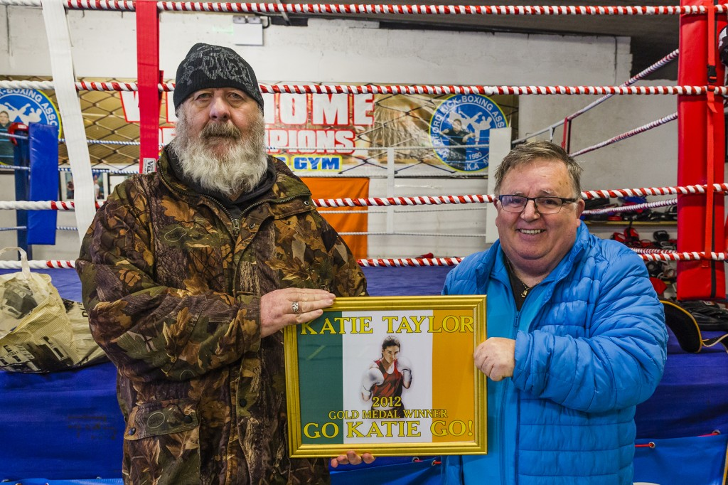 Service users from Brook House presented Billy O'Sullivan with a framed photo of boxing star Katie Taylor as a token of gratitude. Billy is pictured receiving the gift from Nicholas O'Neill.