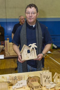 Des Hodge of Déise Men's Shed proudly showcasing his creations.