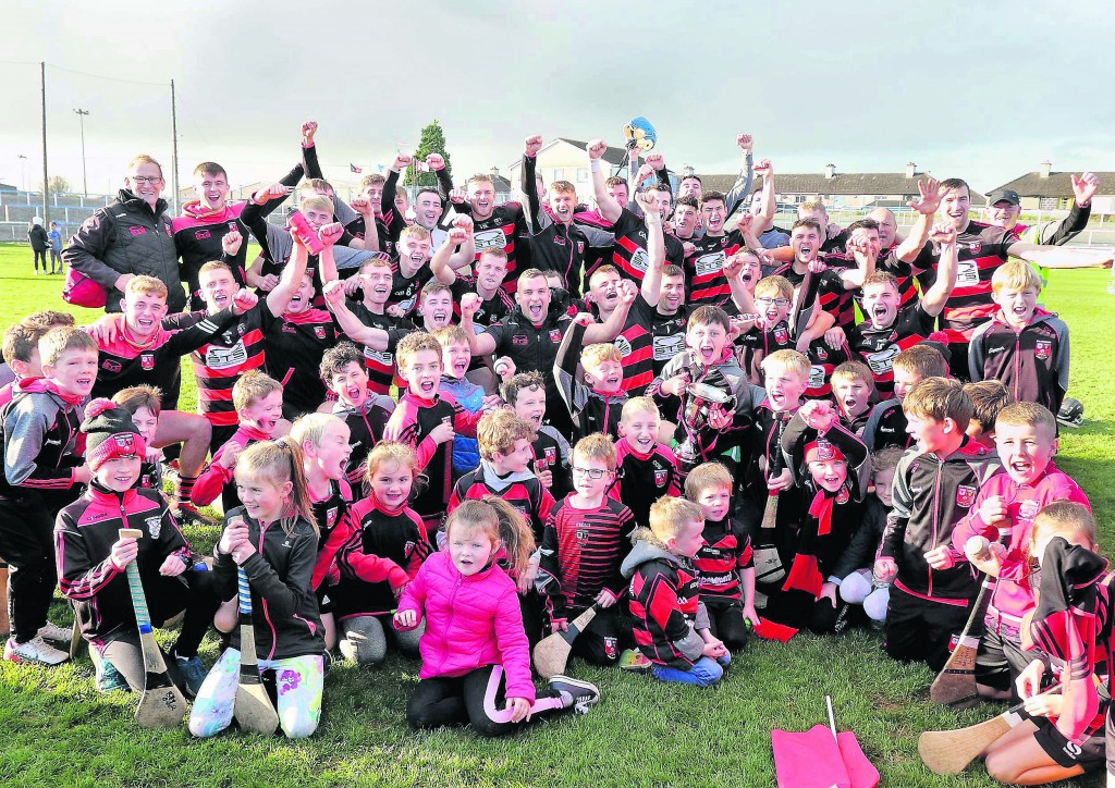 Ballygunner players and mentors celebrate their sixth consecutive county senior hurling title. Photo: Noel Browne
