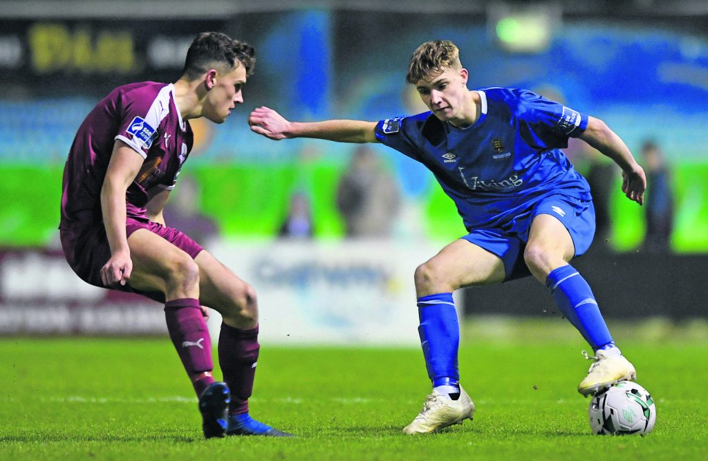 Cameron Power of Waterford in action against Dara Costello of Galway United.
