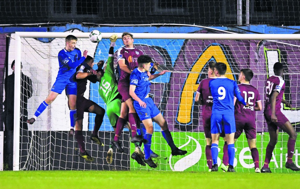Darragh Power of Waterford, left, heads to score his side's second goal, despite the efforts of Galway United goalkeeper Sam O'Gorman.