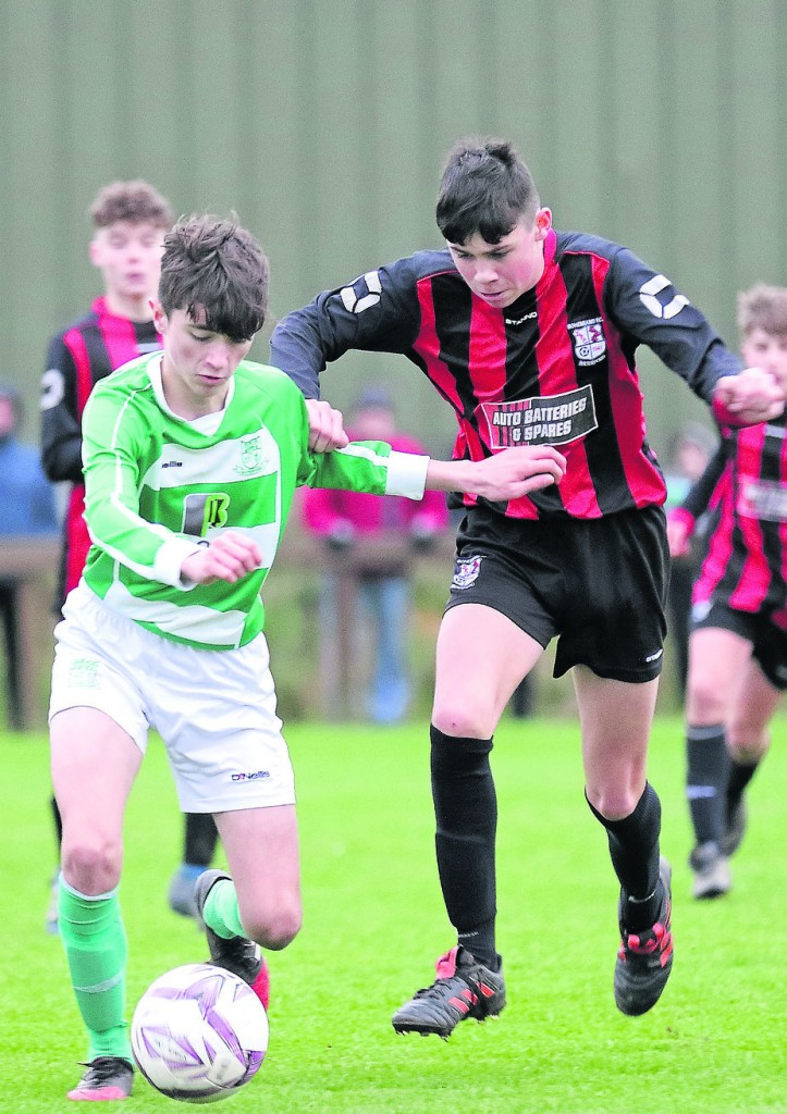 Villa's Jake Coffey in a midfield battle with Bohs Dylan Quinlan-Maher.