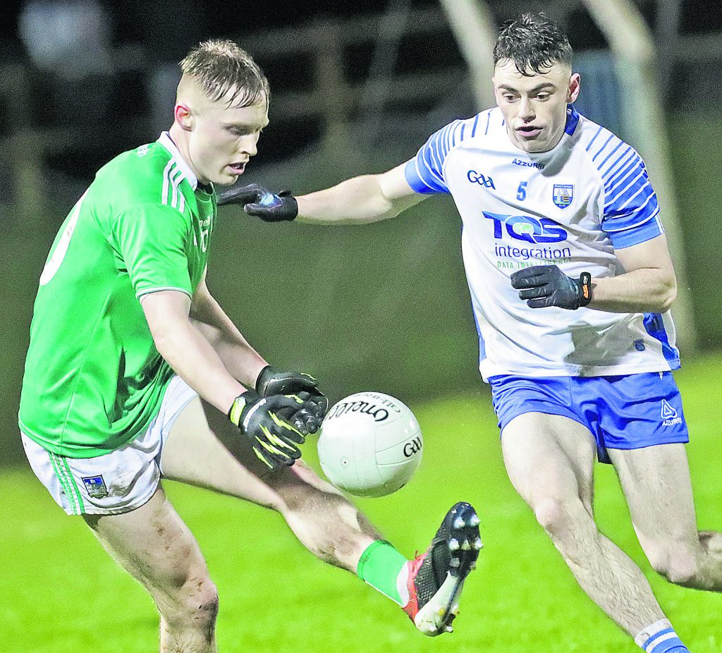 Waterford's Darragh Corcoran about to tackle Limerick's Padraig De Brun.
