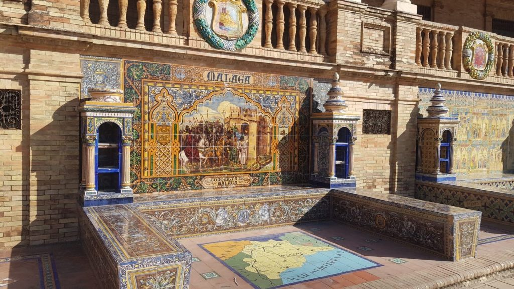 Murals celebrating the different provinces of Spain feature on ceramic tiles.
