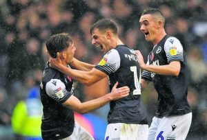 Jayson Molumby celebrating with Shaun Hutchinson and Shaun Williams during Millwall's 1-0 win over Brentford in the EFL Championship recently.