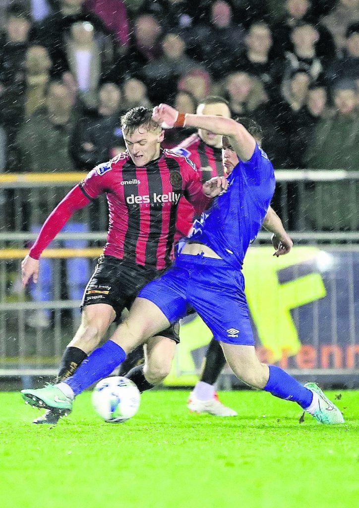 Waterford FC's Scott Allardice gets a great tackle in on Bohemians JJ Lunney.