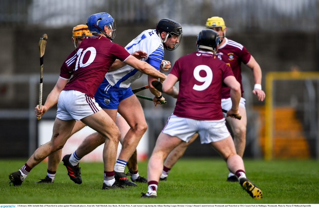 Waterford's Iarlaith Daly of Waterford up against Westmeath players, from left, Niall Mitchell, Joey Boyle, 10, Eoin Price, 9, and Aaron Craig during the Allianz Hurling League Division 1 Group A Round 2 match between Westmeath and Waterford in Mullingar.