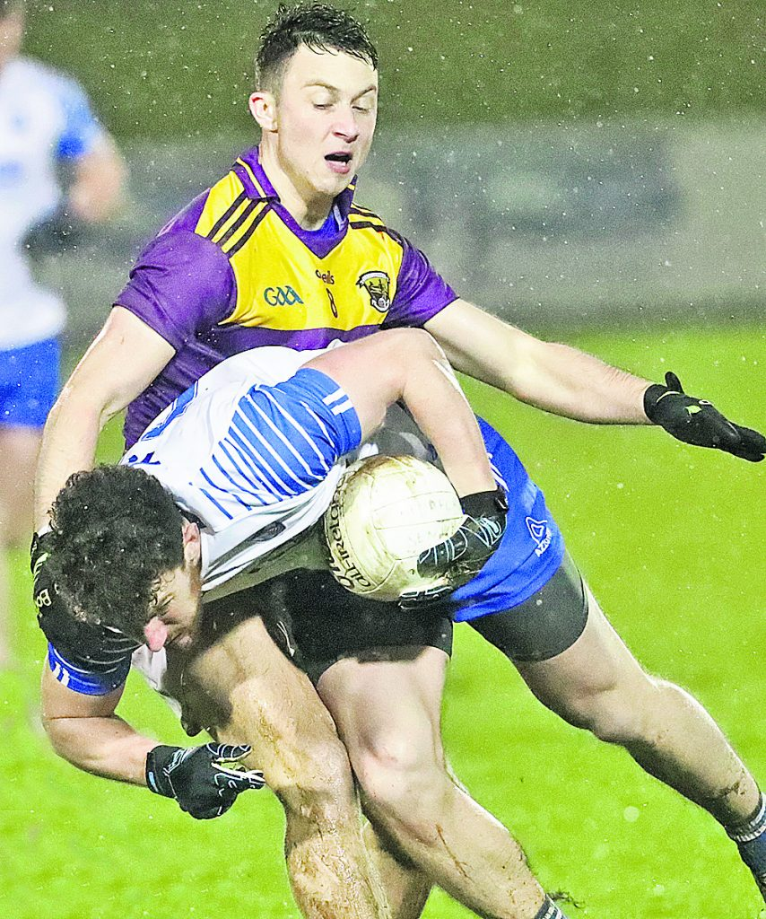 Waterford's Jason Gleeson is tackled by Wexford's Eoghan Nolan