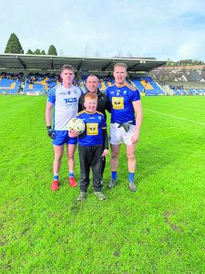 Waterford captain Conor Murray with Wicklow captain Dean Healy, referee David Hickey and mascot Séan Byrne.