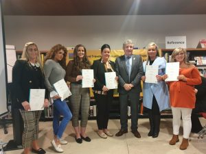 Minister John Halligan presenting certificates to a group of community leaders from Waterford Traveller Community Development Project who recently completed a 2-year QQI Level 5 Major award in Community Development and Leadership.