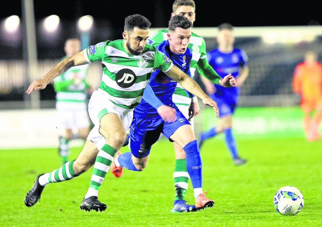 Shamrock Rovers Roberto Lopes in a chase for possession with Waterford FC's Ali Coote.