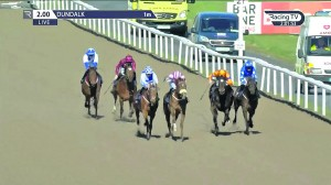 Aerclub (left, blue and white silks) on the way to winning at Dundalk.