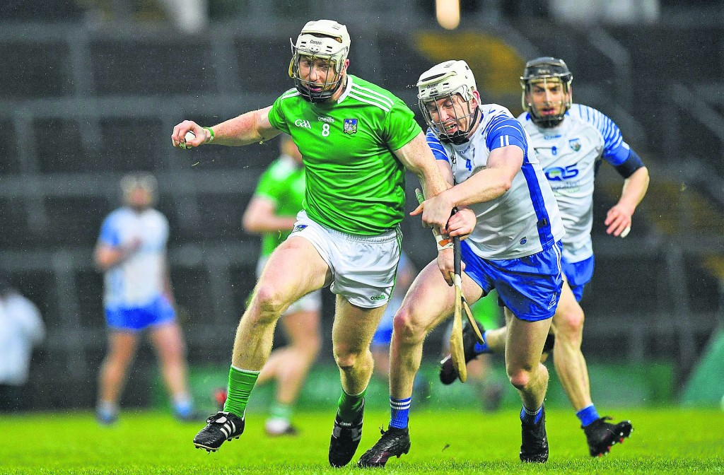 Limerick's Cian Lynch break past the challenge of Shane McNulty