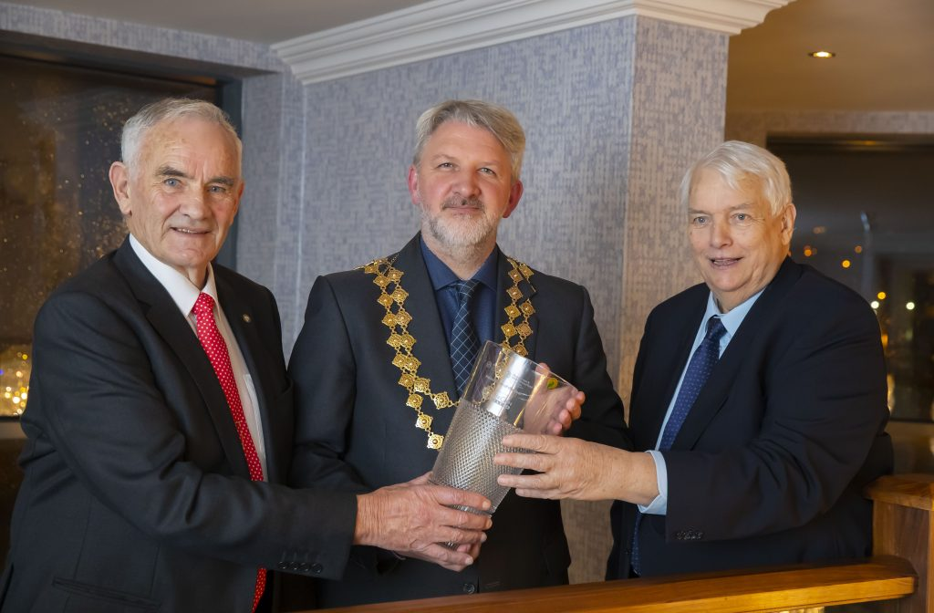 Businessmen John and Peter Queally picked up the accolade of Ambassador of the Year at the Waterford Business Awards. They are pictured with Jonathan Earl, Waterford Chamber President.