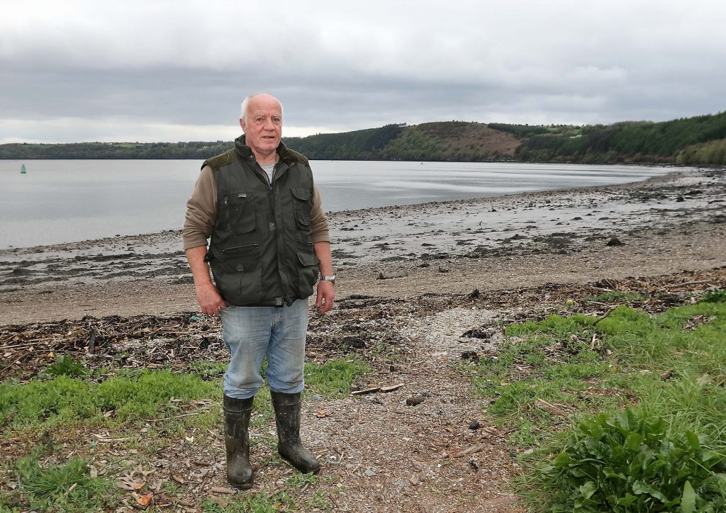 Michael Fortune standing next to the River Suir at Cheekpoint where he has lived all his life. Photo: Noel Browne.