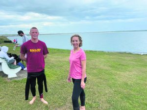 Kathryn Thomas pictured with lifeguard Tom Breen, son of Cllr Lola O'Sullivan,at the Guillamene,Tramore on Saturday